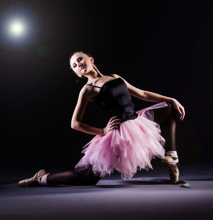 Ballerina dancing in the dark studio Stock Photo - 20574166