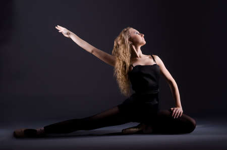 Ballerina dancing in the dark studio Stock Photo - 20574174
