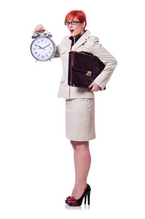 Woman with clock isolated on white photo