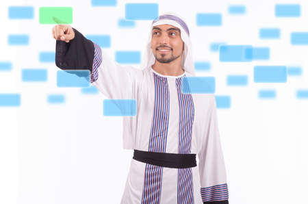 Arab businessman pressing virtual buttons photo