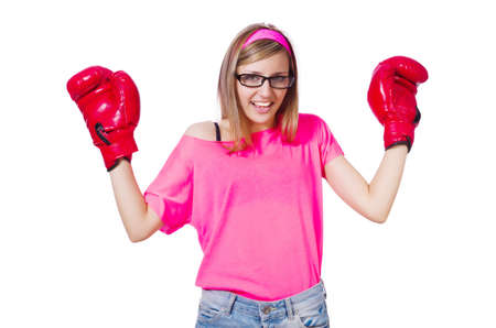 Young lady with boxing gloves on white photo