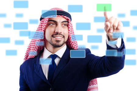 Arab man pressing virtual buttons Stock Photo - 20080263