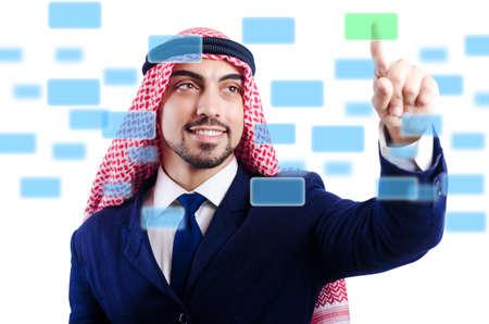 Arab man pressing virtual buttons Stock Photo - 20080263