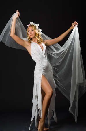 Woman in wedding dress dancing Stock Photo - 20080366