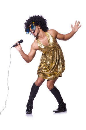 travesty: Man in female clothing singing with mic