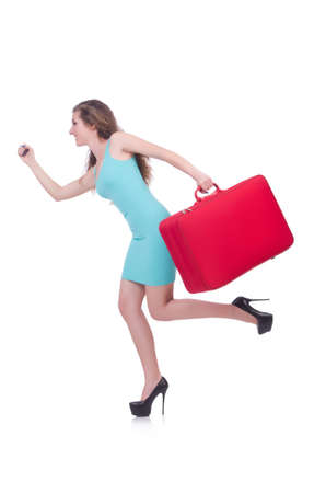 Woman with suitcase before travel photo