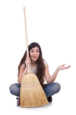Young woman with broom isolated on white photo