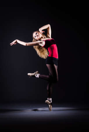Ballerina dancing in the dark studio Stock Photo - 20080588