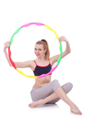Woman doing exercises with hula hoop Stock Photo - 20574365