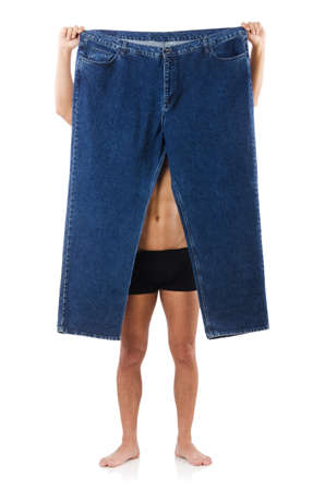 Man in dieting concept with oversized jeans Stok Fotoğraf - 21697150