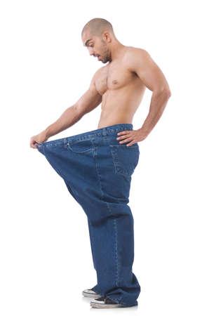 Hombre en concepto de dieta con los pantalones vaqueros de gran tamaño Foto de archivo