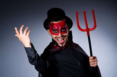 Man in devil costume in halloween concept Stock Photo - 22277966