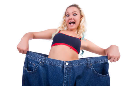 Woman in dieting concept with big jeans Stock Photo - 22476028