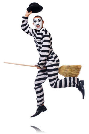 Prisoner with broom isolated on the white Stock Photo - 23510275