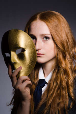 Woman with mask in hypocrisy concept Stock Photo - 23877232