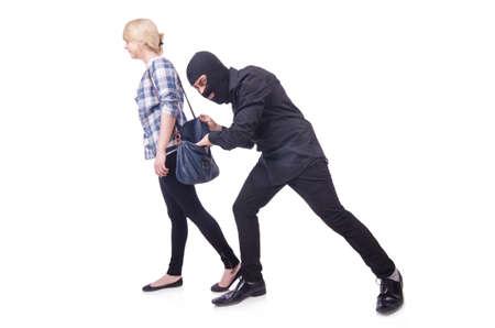 Jonge dief steelt zak van de vrouw Stockfoto