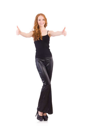 19df23e0508 Redhead woman in black bell bottom pants on white Stock Photo