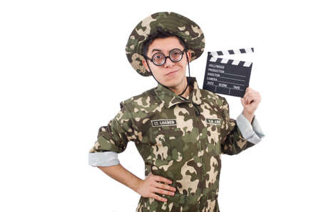 Funny soldier with movie board isolated on the white photo