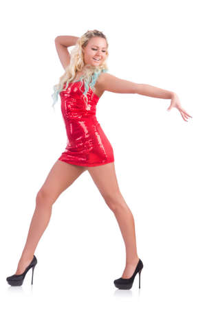 Woman dancing in red dress isolated on white photo