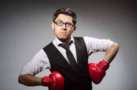 Funny boxer businessman in sport concept photo