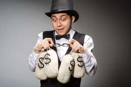 Man with sacks of money photo