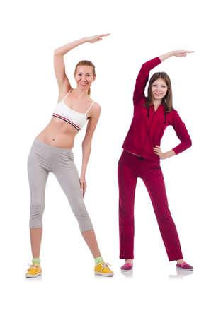 Pair of women doing exercises on white photo