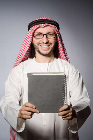 Arab student with book in education concept photo