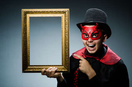 Funny devil with picture frame photo