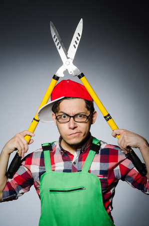 Funny man with giant shears photo
