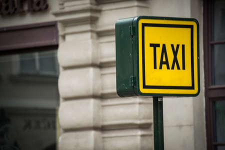 Taxi sign during the daylight hours photo