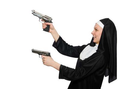 Nun with handgun isolated on white photo