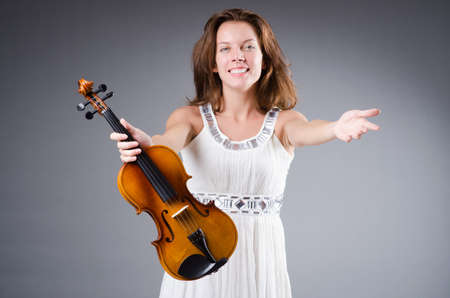 Woman artist with violin in music concept Stock Photo - 30385206