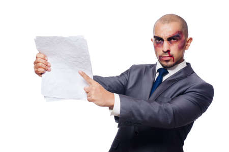 bruised: Badly beaten businessman hold papers isolated on white