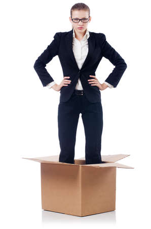 Woman businesswoman in box isolated on white photo