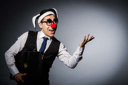 Clown businessman in funny concept photo