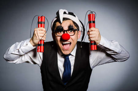 Funny clown with sticks of dynamite photo