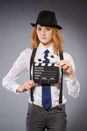 Young woman with movie board   photo