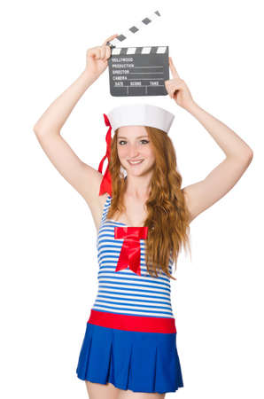 Young woman sailor with movie board photo