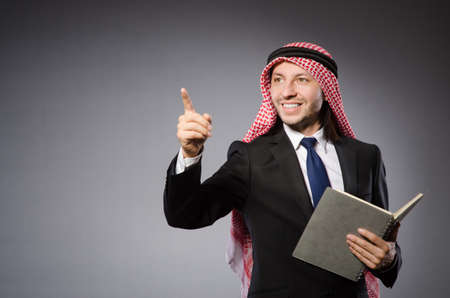 Arab man pressing virtual button photo