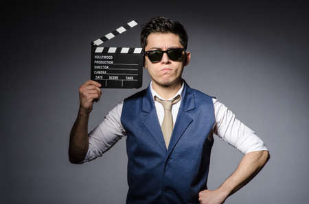 Funny man with movie clapboard 版權商用圖片