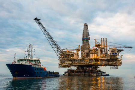Oil rig platform in the calm sea Stock Photo