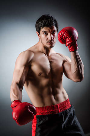 Muscular boxer wiith red gloves Stock Photo