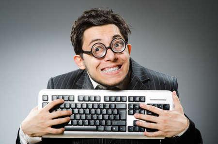 Computer geek with computer keyboard Foto de archivo