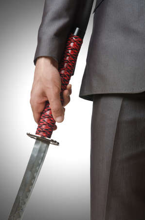 Businessman with sword on white Stock Photo