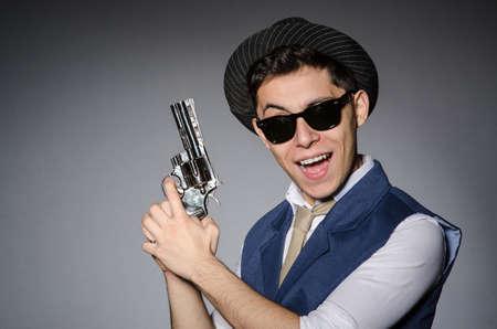 Man Wearing Sunglasses With Gun Photo