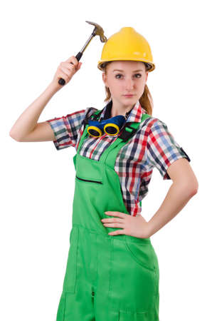 Female handyman in overalls isolated on white