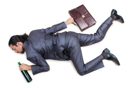 Businessman on the floor isolated on white Stock Photo