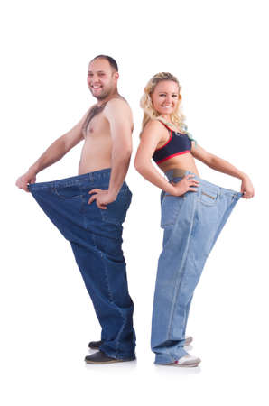 Woman and man loosing weight isolated on white Фото со стока