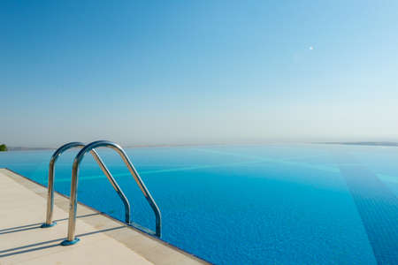 Infinity pool on the bright summer day Stock Photo - 45171941