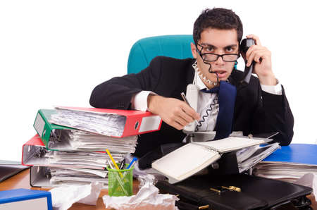 Drukke zakenman onder werkstress Stockfoto